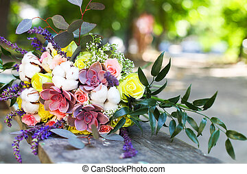 Wedding bouquet with succulent flowers in retro style