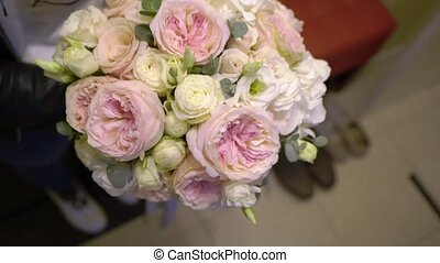 Wedding bridal bouquet of pink and white roses. Woman...