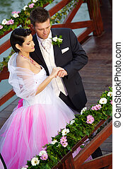 Wedding: Bride and Groom - Bride and groom standing side by...