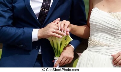 wedding, bride and groom hands with rings