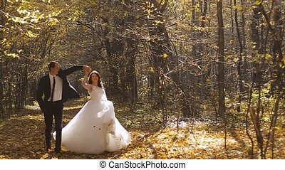 Wedding Bride And Groom Walk in a Autumn Forest. Happy moments