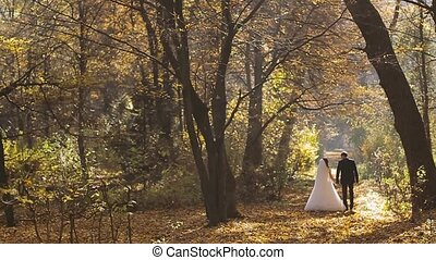 Wedding Bride And Groom Walk in a Autumn Forest