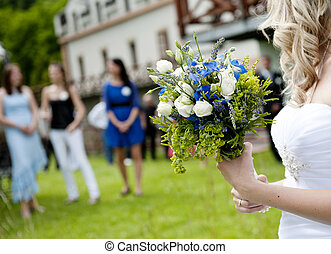 Wedding - Bride is ready to throw away her wedding bouquet