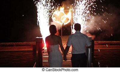 wedding burning hearts fireshow - newlyweds go to the...