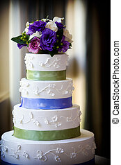 Wedding cake - A large multi level wedding cake with purple...
