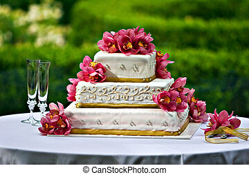 Wedding Cake - A three layered wedding cake with floral...