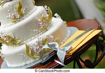 wedding cake and a cutting knife