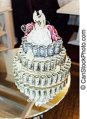 wedding cake made of money, treasure chest