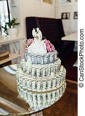 wedding cake made of money, treasure chest.