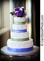 Wedding cake - A large multi level wedding cake with purple...