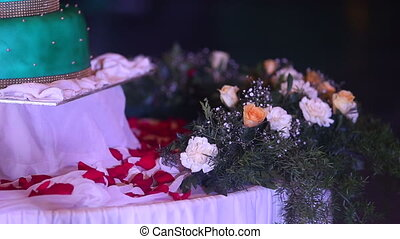wedding cake stands on a table surrounded by fresh flowers