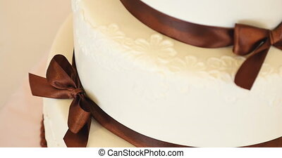 wedding cake with brown bows.