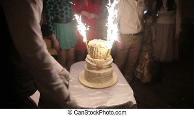 Wedding cake with burning fireworks