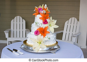 Wedding Cake With Flowers - A bride\'s wedding cake sits...