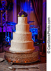 Wedding Cake with purple flower topper - Image of an elegant...