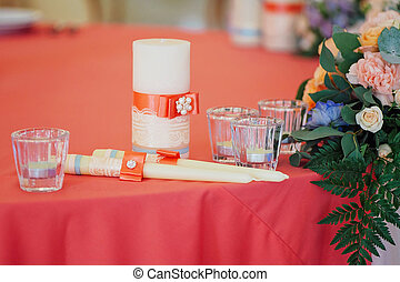 Wedding candles decorated with bow and ribbons