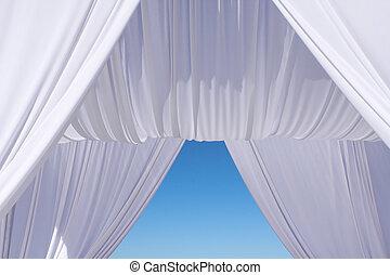 Wedding canopy under blue sky