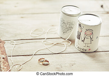 Wedding cans decoration with ribbons and the rings