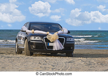 Wedding car on a beach with a beautiful sky in the ...