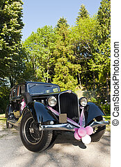 wedding car - particular of an old car decorated for a ...