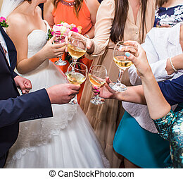 Wedding Celebration. Hands holding the glasses of champagne...