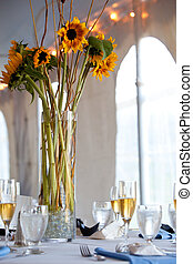a large wedding table centerpiece with a sunflower bouquet