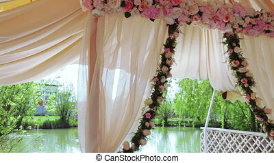 Wedding ceremony at river - Camera on steadicam flies under...