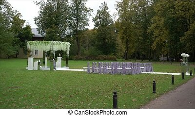 Wedding ceremony decoration outdoors at cloudy day