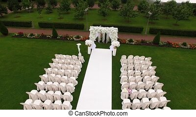 Wedding ceremony decoration aerial drone shot