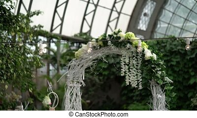 Wedding ceremony decoration in greenhouse