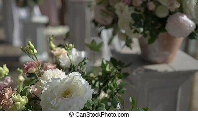 Wedding ceremony decoration with flowers outdoors