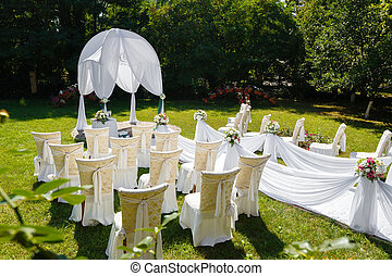 Wedding ceremony decorations in the park at sunny day