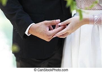 Wedding ceremony. Groom and bride holding hands together