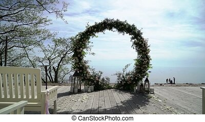 Wedding ceremony outdoors decorated with flowers