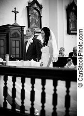 Wedding ceremony - Bride and groom in church at the wedding...