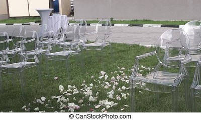 Wedding ceremony place sitting. Chairs for wedding guests. Wedding chairs set up before the ceremony