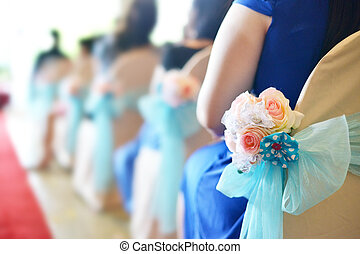 Rows of chair in wedding ceremony, focus on flower bouquet