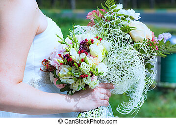 wedding Ceremony - bride in a white dress holding a wedding...