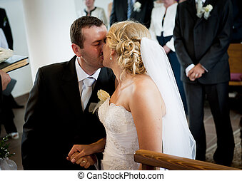 Wedding ceremony - Bride and groom in the church at the...