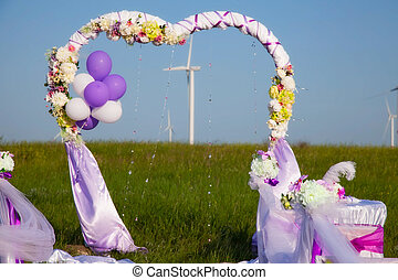 wedding ceremony in a field with windmills