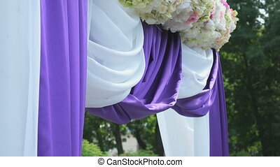 Wedding ceremony tent outdoors in park area