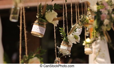 Wedding. Ceremony. Wedding arch. Wedding arch made of wild flowers and wheat ears in banks