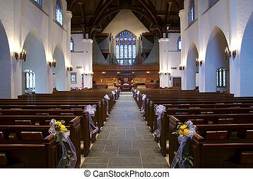 Wedding Chapel - Looking down the aisle of a church...