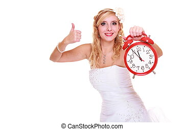 Wedding concept. Time to get married. Bride with clock.