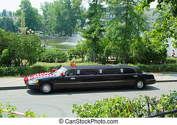 wedding cortege. - Chic black car decorated with flowers ...