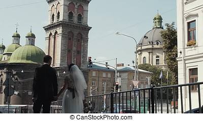 Wedding couple at a walk in the city
