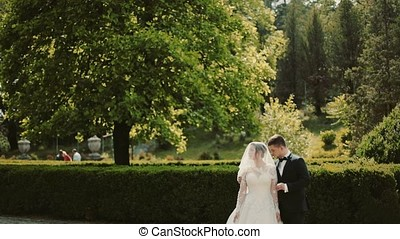 Wedding couple at a walk in the park