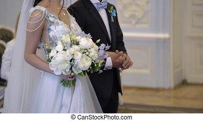 Wedding couple at ceremony indoors