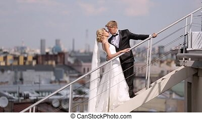 Wedding couple at the roof in the city