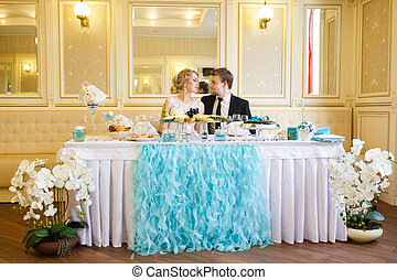 Wedding couple at the table